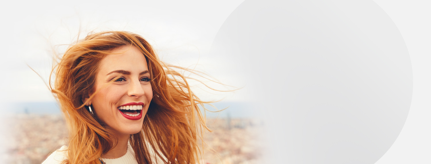 Smiling woman with red flowing hair